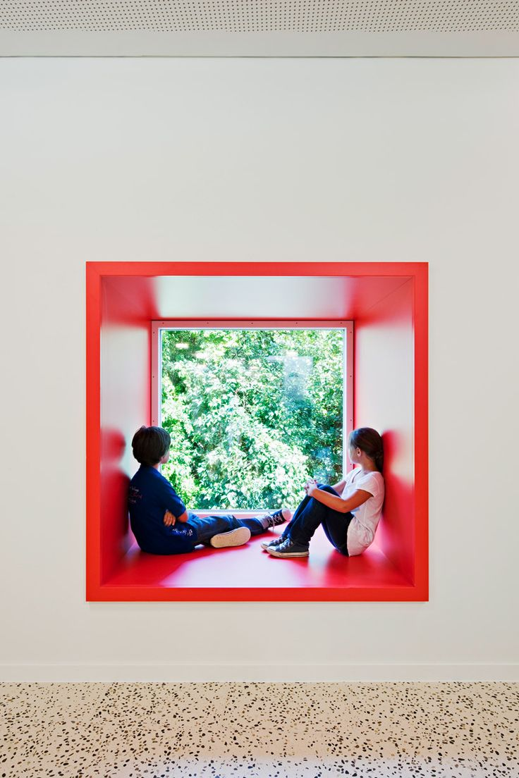 MAGK + illiz architektur, childcare center, maria enzersdorf. Deeplu inset windows, create miniature spaces for dwelling.