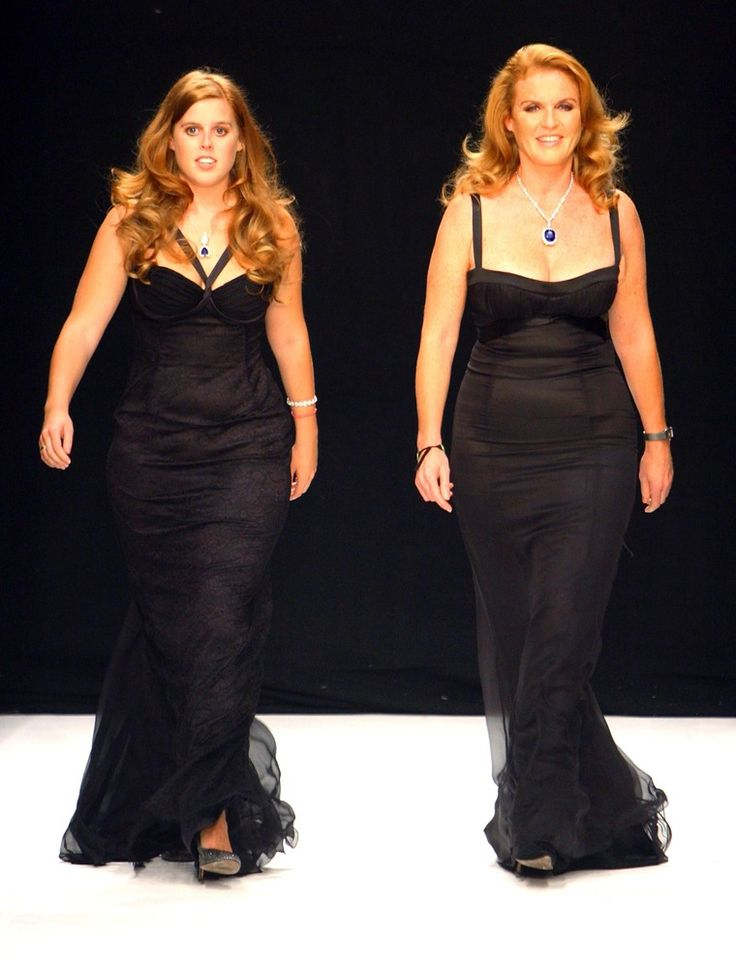 9/20/2007: Princess Beatrice & Sarah, Duchess of York walk down the catwalk during the Fashion For Relief fashion show.