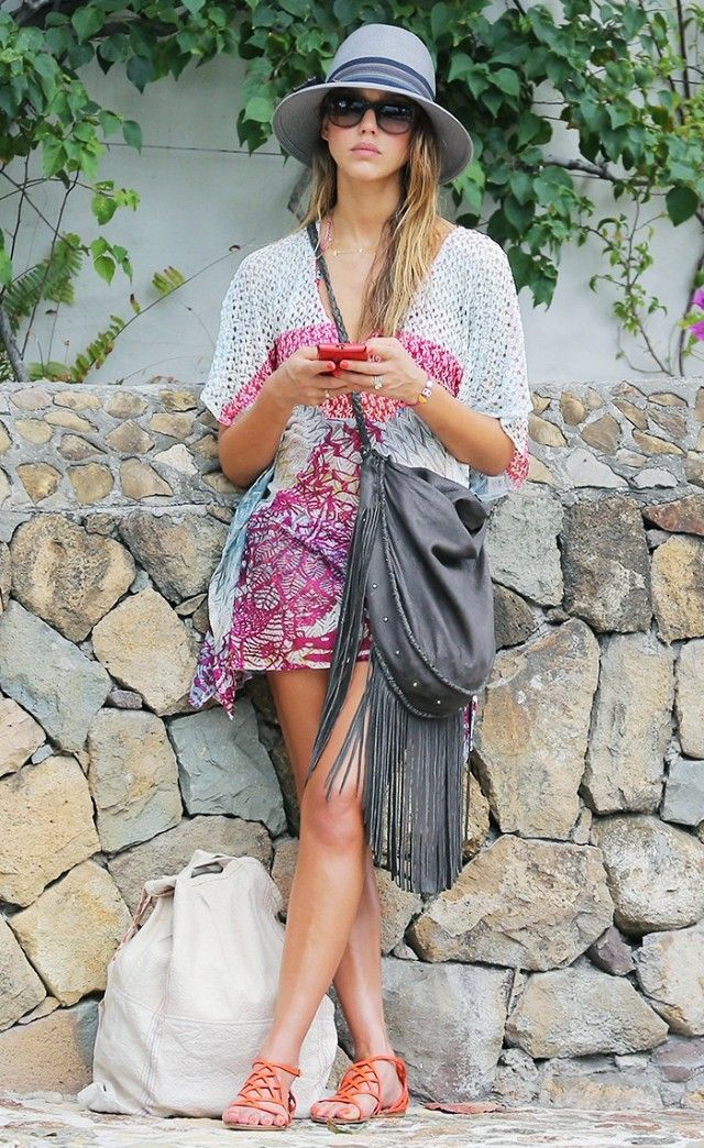 Accessorize a printed cover-up with boho accessories, like a medium-brimmed hat, a fringed bag, and gladiator sandals.