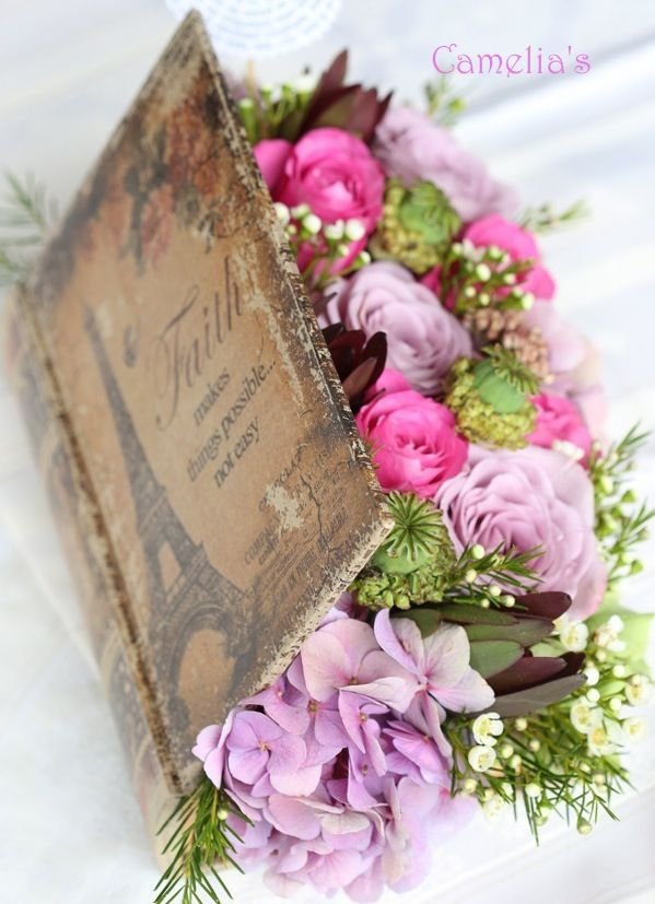 use an old book to make this (take out pages, then line with plastic) Vintage Flower Arrangements You Must Do This Spring