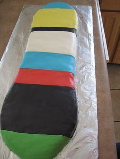 how to make a snowboard cake | ... the same icing to make the binding lines/dots and the Burton sign