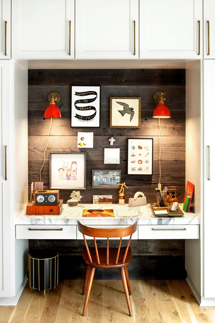 A home-office alcove in the family room is decorated with a variety of artworks and light fixtures from Schoolhouse.