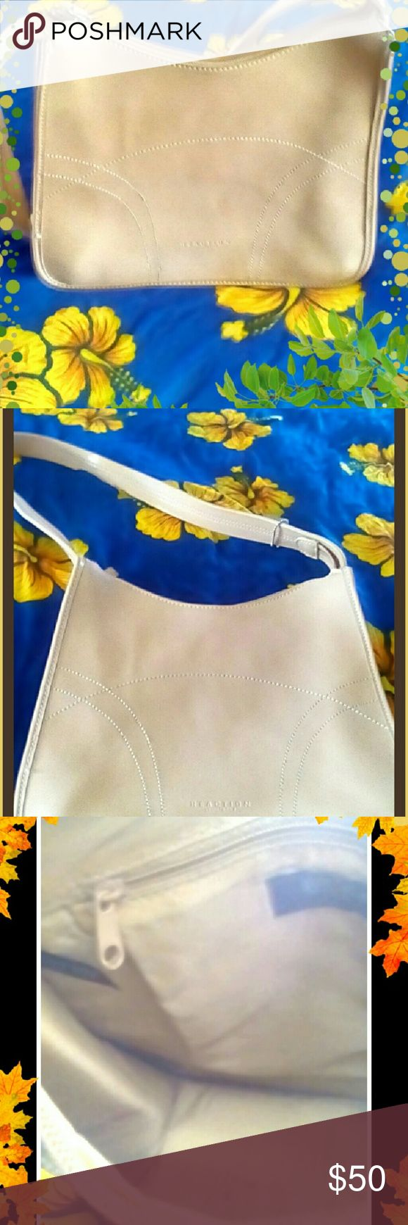 🌞Michael  Cole Reaction over the shoulder purse🌞 Michael Cole  Reaction Patent leather over the shoulder purse. The purse is in perfect condition the only thing as you can see from the picture posted the inside bottom of the purse has some stains from a makeup stick. Only noticeable if looking for it and could be removed if cleaned. Michael Cole  Bags Shoulder Bags