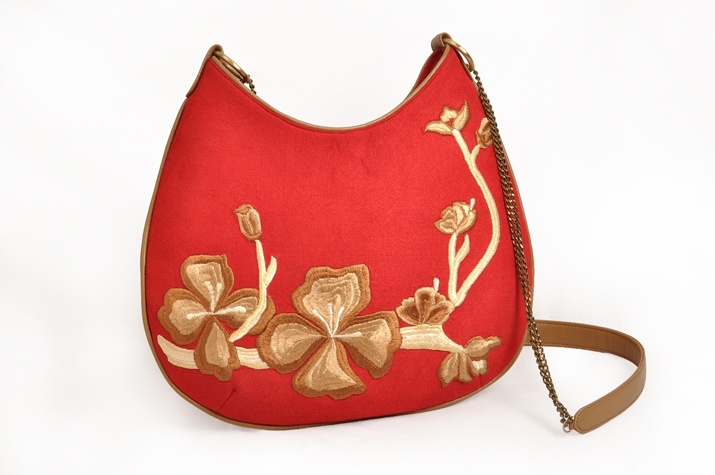 Which Bag are You? Fun and Bold- a siren red messenger bag with floral embroidery from Pimento's Cornucopia collection?