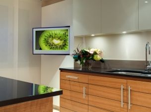 Sony LCD TV on pull & rotate wall bracket in the kitchen