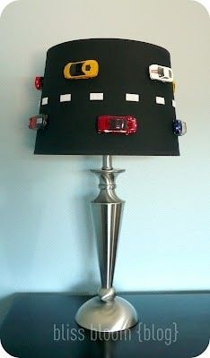 If you use lamps in your classroom, this would be an AWESOME addition to the racing classroom theme! Simply get a black shade, add some white tape, and glue cars into place! Genius!!