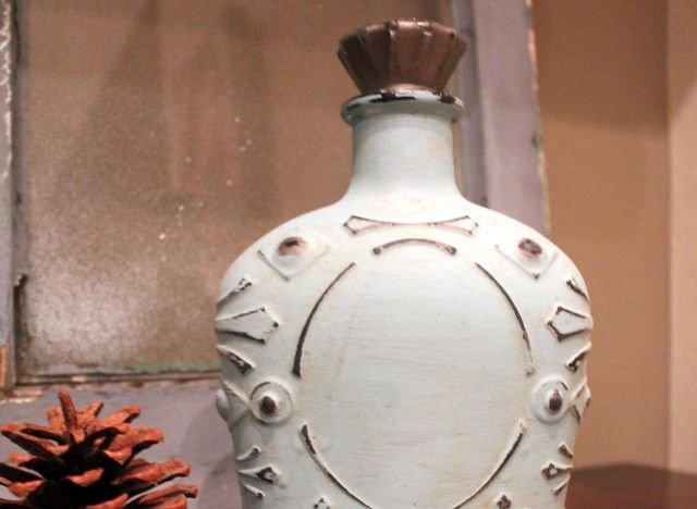 Paint and repurpose old liquor bottles for decor