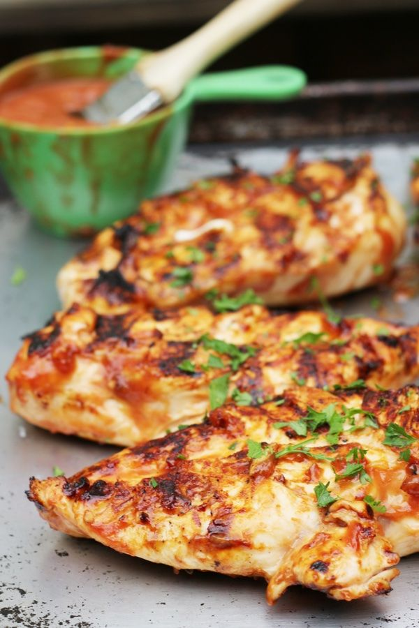 BBQ chicken breast on the grill with homemade BBQ sauce. Yum!
