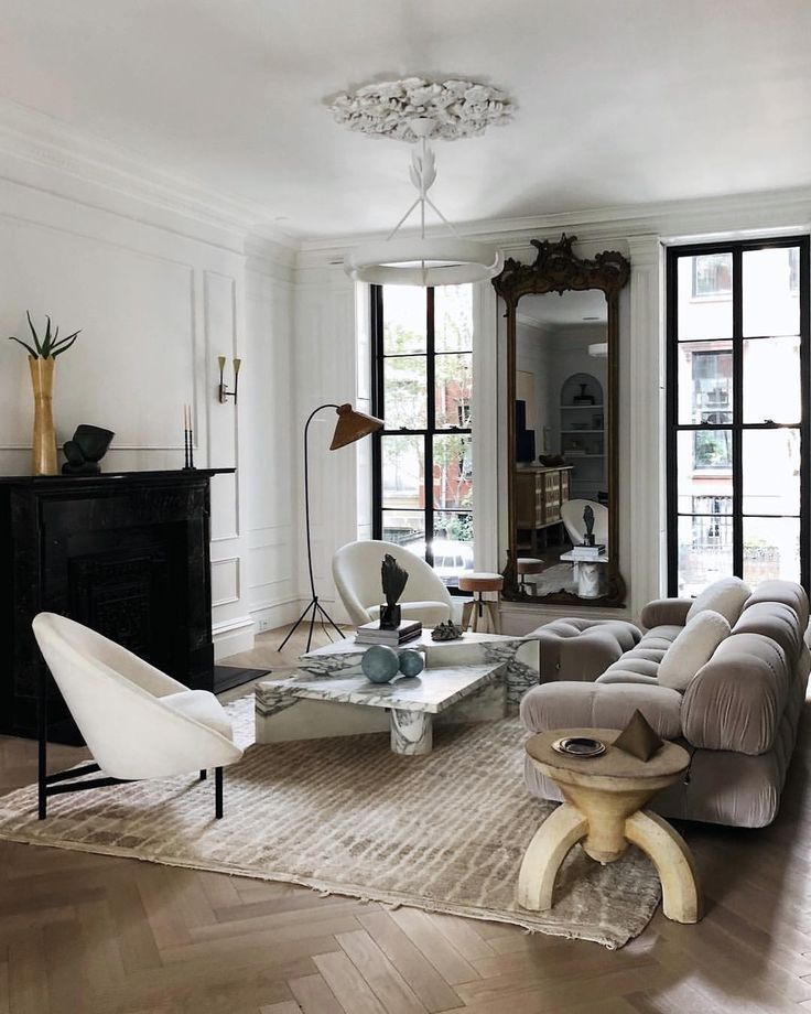 Great living space with fun accent chair and modern lighting ...