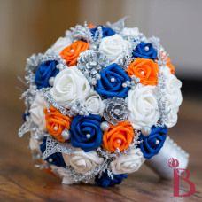 Royal blue and tangerine orange unique wedding bouquet for wonderland weddings #winterwonderland #thebridalflower