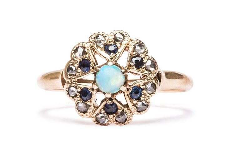 15393a6b723 The Victorian Opal Ring is a wonderful vintage sapphire and opal ring made  from yellow gold