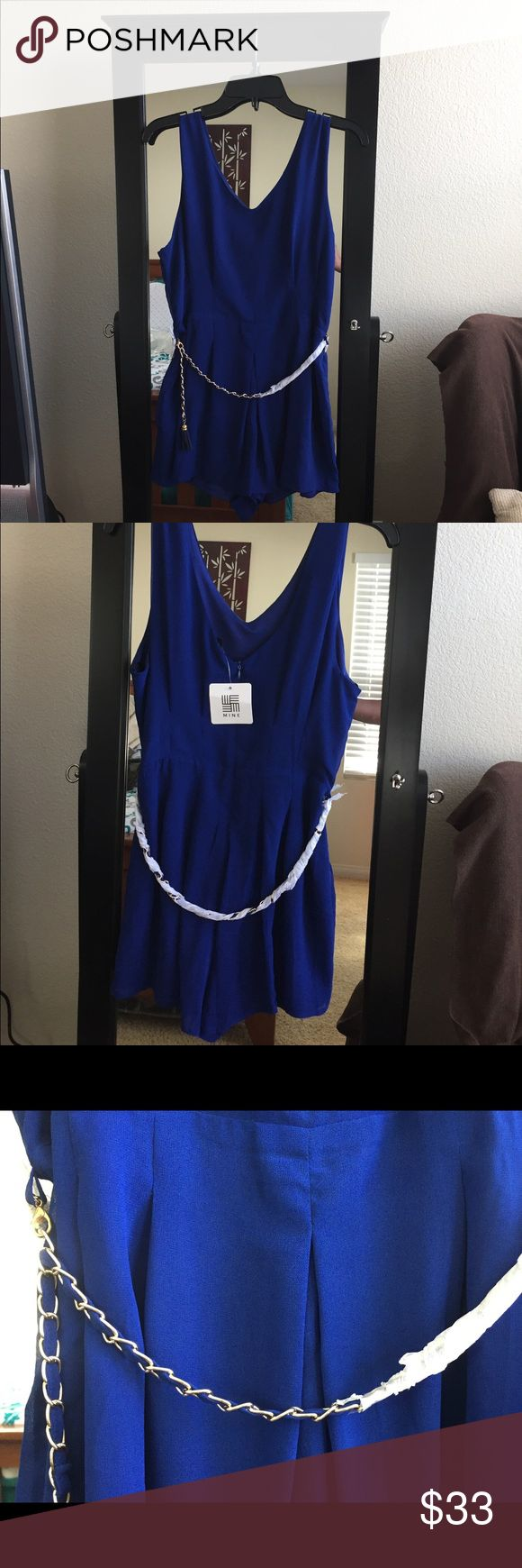📌Blue Romper w/Gold Link Chain Belt 📌Size:12 Beautiful blue mid thigh length romper with flared short bottom. Hits your curves in all the right places and comes with a gold link belt to accentuate your waistline. Pair with some heels and gold accessories to jazz it up! Mine Clothing Brand Shorts