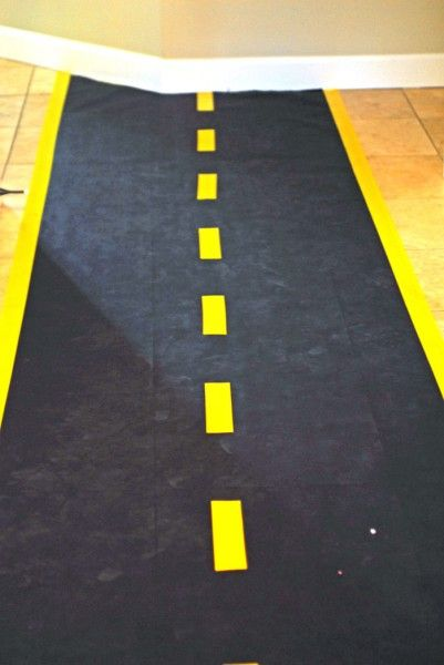 road: black butcher paper {teacher supply store?} and yellow duct tape