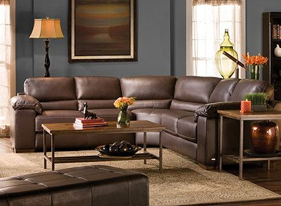 Bluish-gray walls with brown furniture and orange accent pieces