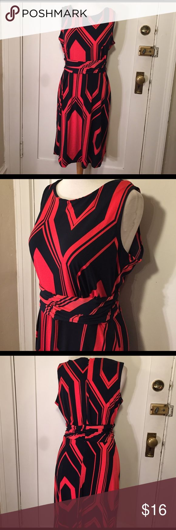 NY Collection Orange navy chevron zigzag dress NWT This is a beautiful dress from NY collection,Red orange design and navy zigzag, almost a Chevron print. See pictures for details. New with tags's. Be sure and check out other items in closet and bundle to receive discounts. NY Collection Dresses