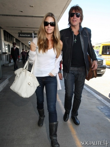Actress Denise Richards was seen departing LAX with boyfriend, Bon Jovi guitarist Richie Sambora, in Los Angeles, California on June 5, 2012.
