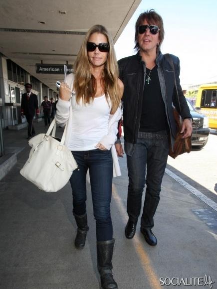 Actress Denise Richards was seen departing LAX with boyfriend, Bon Jovi guitarist Richie Sambora, in Los Angeles, California on June 5, 2012.