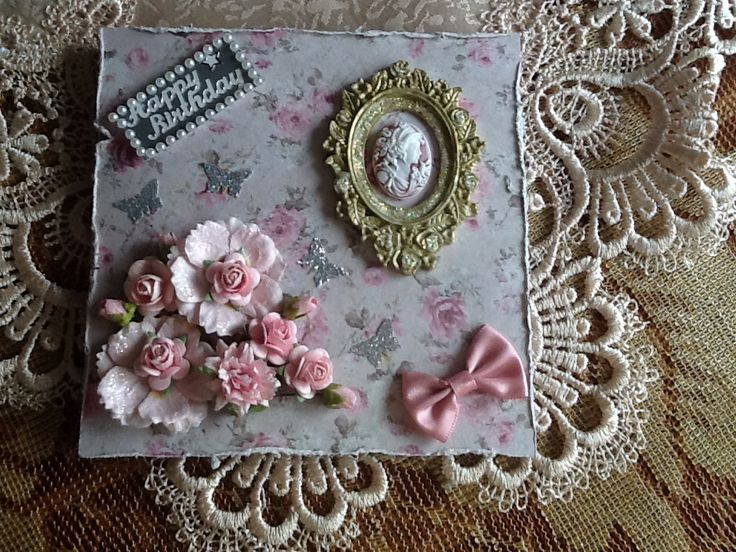 Background paper from my stash,cameo from USA,frame from a mould, flowers are Prima