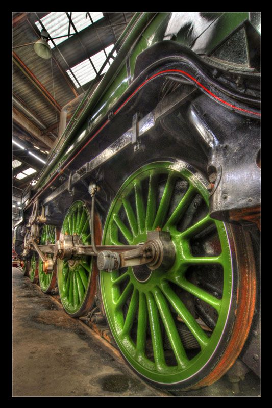 """""""Driving Wheels"""" Driving Wheels of the 'Blue Peter' steam locomotive 'resting' in the Barrow Hill Roundhouse in Chesterfield, Derbyshire. HDR Photo by Simon Bull"""