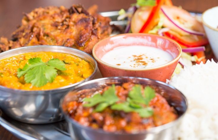Scene Indian Street Kitchen - Lunch Time Thalis with a poppadom, onion bhaji and dip, salad, two chef's curries and pilau rice.