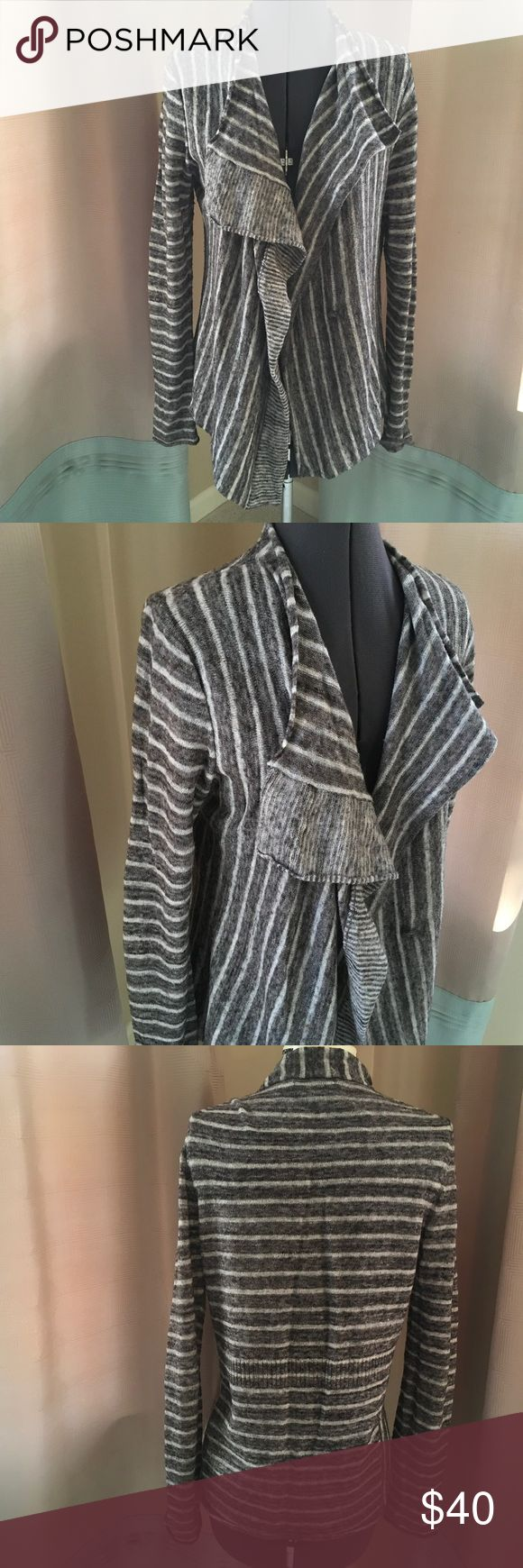 Banana Republic Long Gray/White Shrug Great light sweater layer of gray and white stripes. Wool/poly/nylon/alpaca blend. Elegantly drapes into ruffles in the front. In like-new condition. Banana Republic Sweaters Shrugs & Ponchos