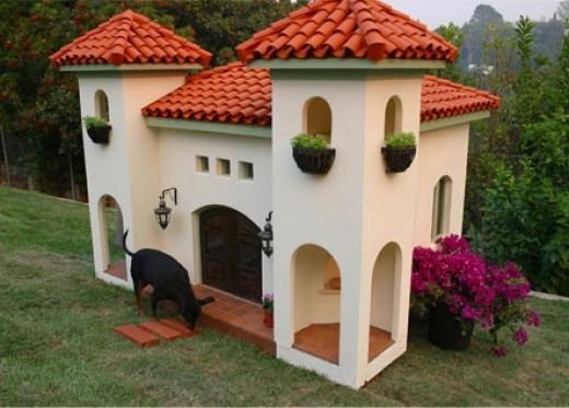 """Stucco Pet Mansion At first I didn't see that it was for pets, and I thought it was a kid's play house ... THAT was """"WOW!!"""" THIS .... This is just totally INCREDIBLY WIERD!!"""