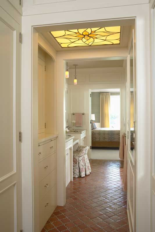 """Linking the bedroom to the bath by way of a """"master hall"""" equipped with storage, sinks, and a vanity is an economical use of space in the retrofit of a 1913 historic building by David Heide Design Studio. (Photo: Susan Gilmore)"""