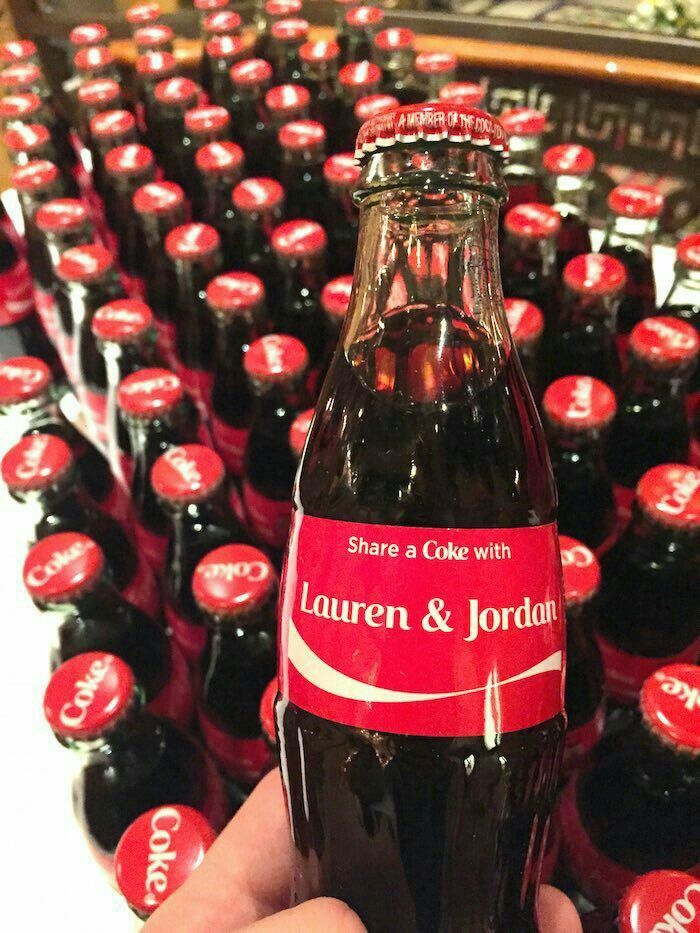 Personalized Coca-Cola bottles as wedding favors.