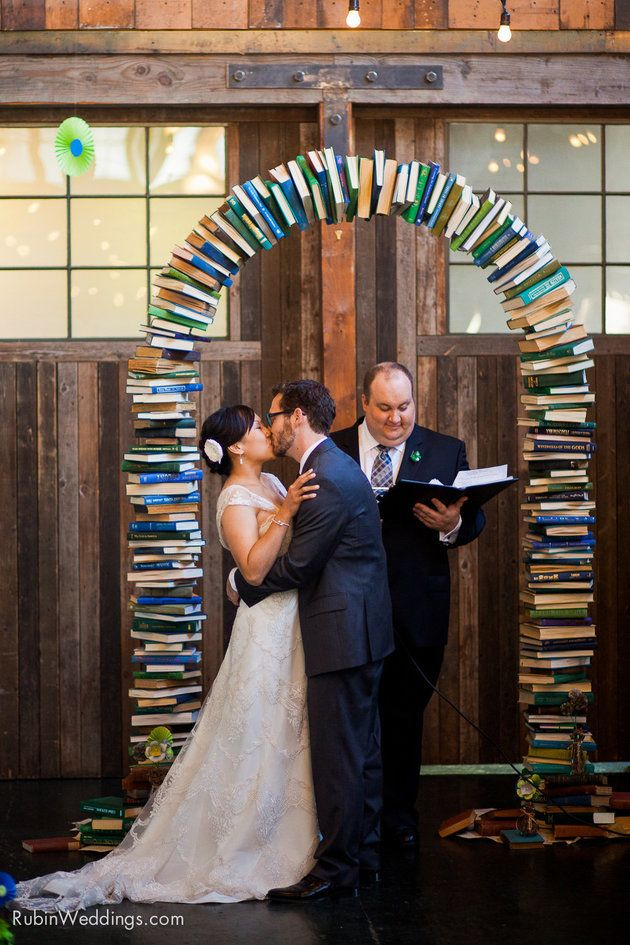 Show off your love of books with this stunning arch at your wedding ceremony! | Alexander Rubin Photography