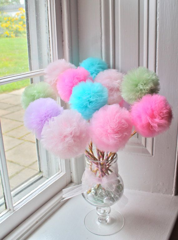 Fun, colorful tulle pom pom wands are great for parties, room decor, or play. Get one and its a magic wand. Get them in a bunch and they are party favors, trufula trees, or the cutest centerpiece! Use them for a princess or fairy party as a magic wand! Great idea for a shower or baby gender reveal party, too! Party favors, dress up play, party games, party centerpiece. Lots of uses!  This listing is for a set of (10) pom pom wands - any color combination. Each comes on a custom, painted…