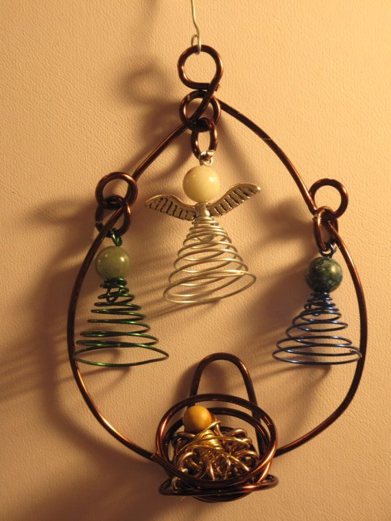 Nativity, This ornament is handmade and wire wrapped into this adorable little nativity scene! Each person has a different color the angel is silver, Joseph is blue, Mary is green, and baby Jesus is gold. The heads are small round glass beads to match the wire. The whole ornament is about 4 inches long, and complete with a handmade wire hook to hang on your tree