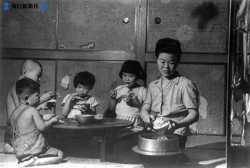 Family eating. Japan. Vintage.