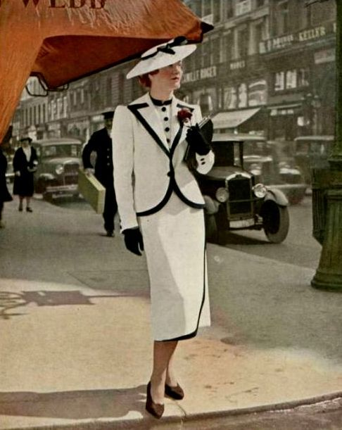 Tailor made suit by Paquin, photo Seeberger, 1937 black and white suit dress color photo street print ad hat