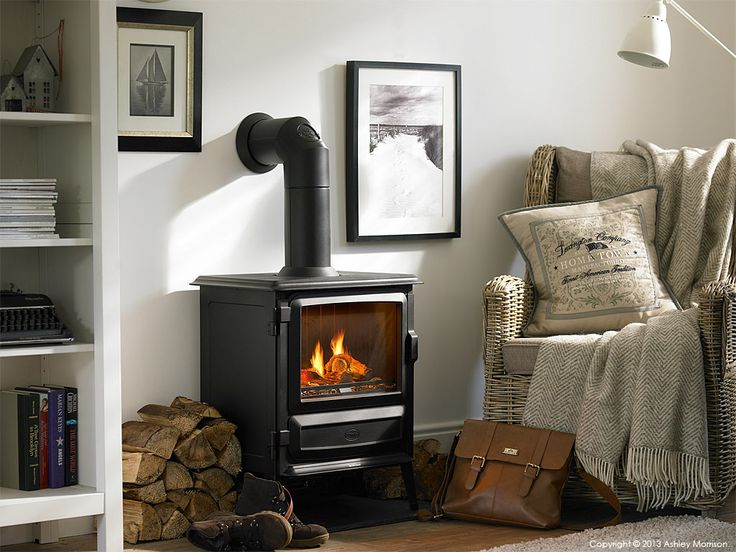Electric stove in the living room of Marie & Alan's Belfast home by Ashley  ... - 25+ Best Ideas About Electric Log Burner On Pinterest Electric