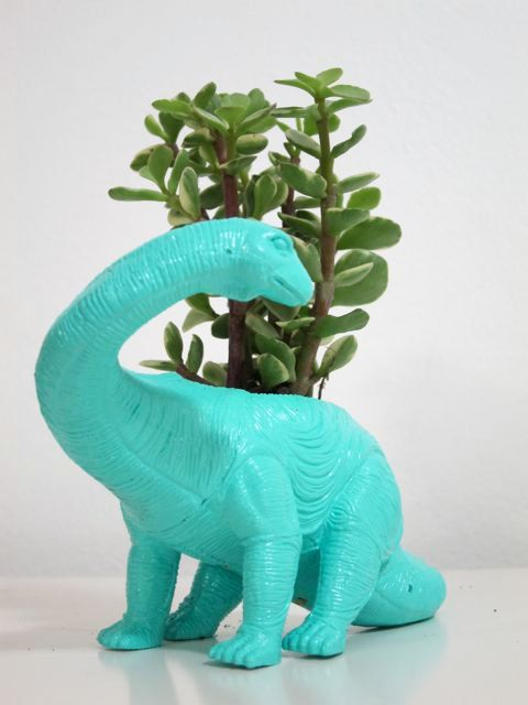 Dinosaur! Not the planter bit, but maybe find old dinosaur toys at thrift stores and spray paint them?