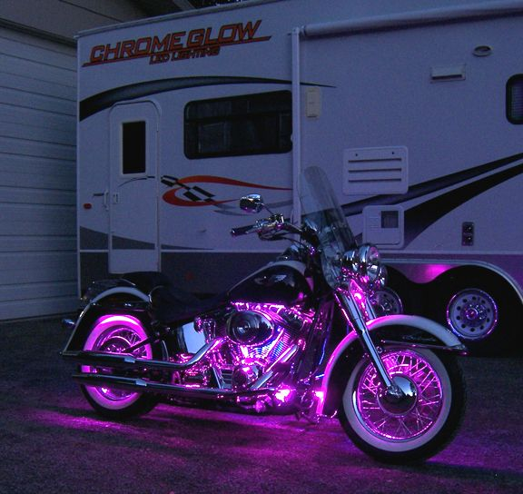 suzuki motorcycle pink | under lights