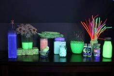 DIY Our new glow area/materials. Glow in the dark bubbles, glow sand, glow silly putty, moon rocks, glow water beads, glow paint, glow powder, glow water, pipe cleaners, rocks, blocks, shells, and sticks all painted in glow paint. :-)