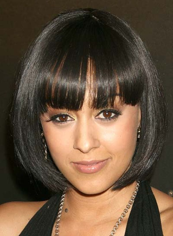 African American Bob Hairstyles with Bangs - Find lots of fabulous short hair styles for black women worldwide at 1966mag.com