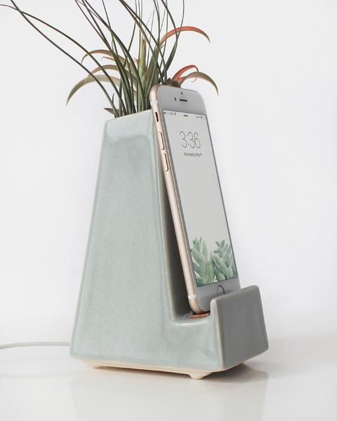 Form meets function. It seems we're all in need of good place to charge our phones — why not do it in style? With a compartment in the back, this phone dock can hold pens and pencils or since its wate
