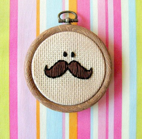 oh If I were only this crafty. A cross stich mustache! He looks like the pringle guy!!!