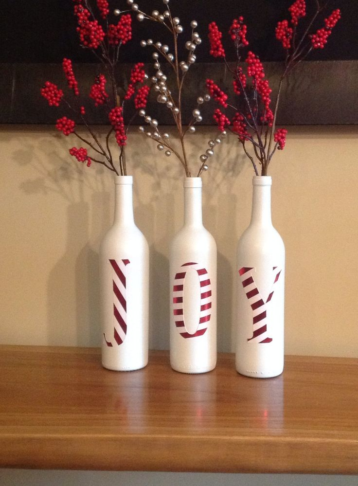 Previous pinner wrote... Get bottles, soda bottles,beer bottles, or wine bottles. Cover a part of a bottle in red paper. Spray paint everything else white and cover the red with stripes of white, and turn it into letters.