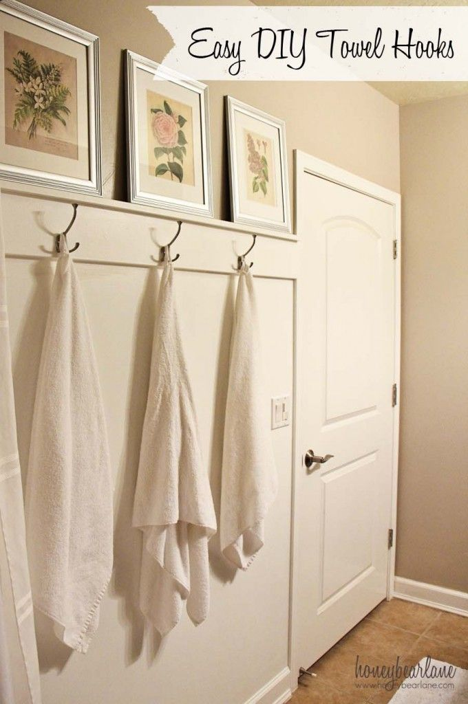 easy DIY towel hooks--this whole bathroom makeover looks simple and nice.