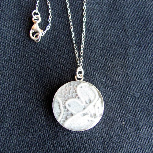 Put a piece of your wedding dress gown into a necklace. Such a cool idea. My dress has a big stain on it and I never knew what to do with it.  I could make a number of these and give them to any future brides of my grandsons as the something old.....