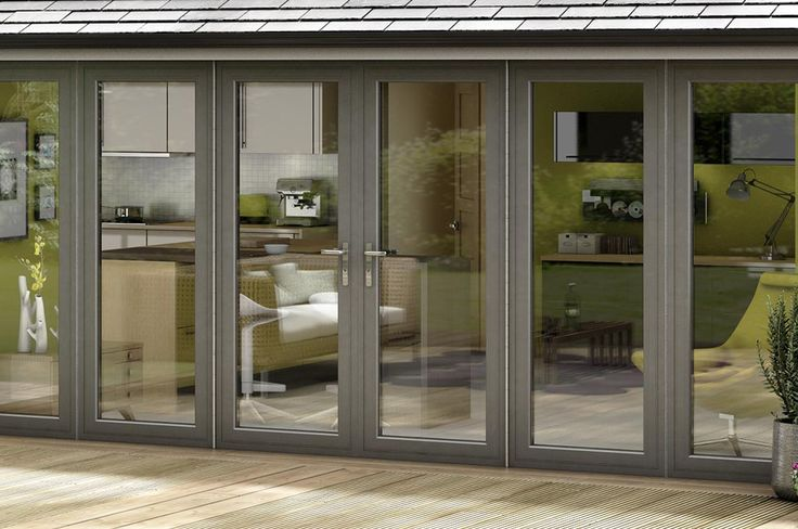 Grey Bi Fold Doors on an Everest Tiled Roof Extension with silver handles