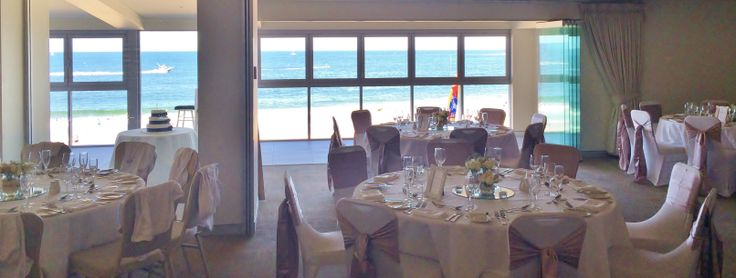 The entire eastern wall of the function room at The Surf Club Mooloolaba is floor to ceiling glass with windows that open onto the beach. Stunning.
