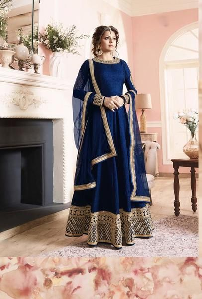 This suit is designed with elegant embroidery . TOP: Vaidhi Silk BOTTOM: Santoon INNER: Santoon DUPATTA: Net COLOUR: Blue TYPE: Semi-Stitched SHIPPING