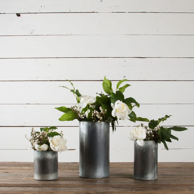 Zinc Norah Vase.  I love these distressed metal vases.  Can also be used as pencil holders, etc.
