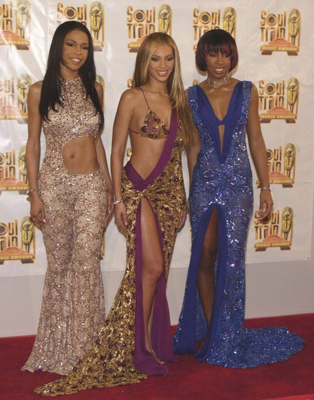 Musical group Destiny's Child poses for photographers at the 15th Annual Soul Train Awards February 28, 2001 at the Shrine Auditorium in Los Angeles, CA.