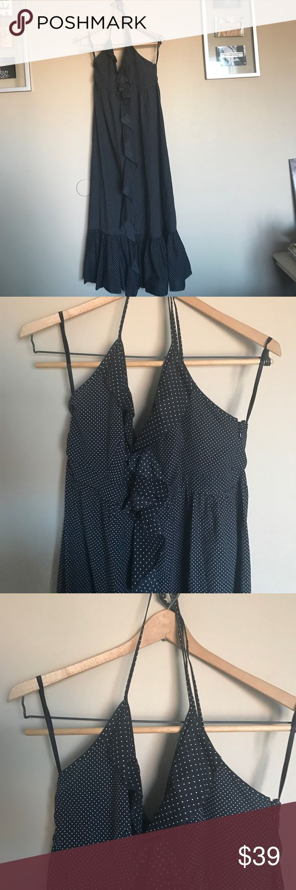 J Crew black polka dot ruffled festival dress J Crew black and white polka dot ruffled festival dress. Maxi type, mid calf dress with ruffled detail front and halter tie. Excellent condition. Two sizes of white polka dots on black based  Halter dress with spaghetti straps. Maxi that hit mid length A wide ruffle extends from the mid-bust line to the hem Unlined Hidden side zipper Great condition, free of tears, spots, and stains. No flaws. J. Crew Dresses Maxi
