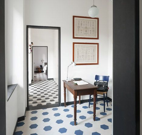 Hexagonal tiles create honeycomb-patterned floors inside thisnineteenthcentury ItalianhouserefurbishedbyarchitectsGrooppo.